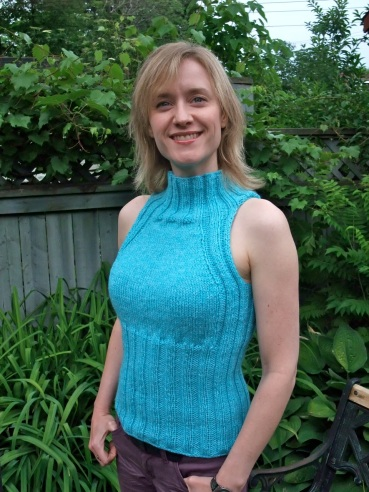 "The ""Perfect Periwinkle Turtleneck Tube Vest"" pattern, in turquoise Cascade 220 wool."