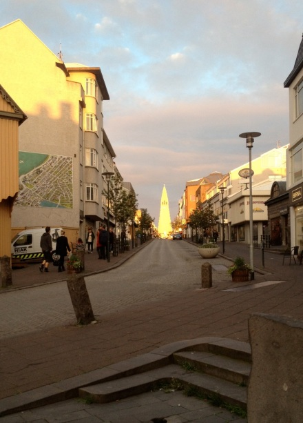 A view up one of Reykjavik's downtown streets, looking at the Hallgrimskirkja reflected in the near-midnight sun.