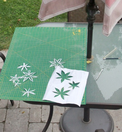 Cutting the flower motif out of mac-tac...in my 'outdoor studio'