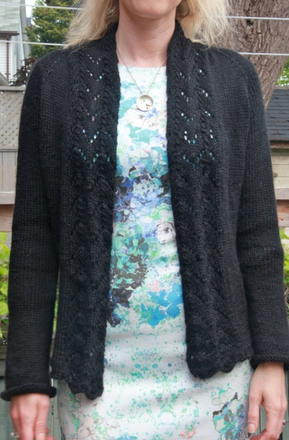 Black knitted cardigan with lace collar