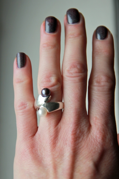 Cast silver ring with black and white pearls