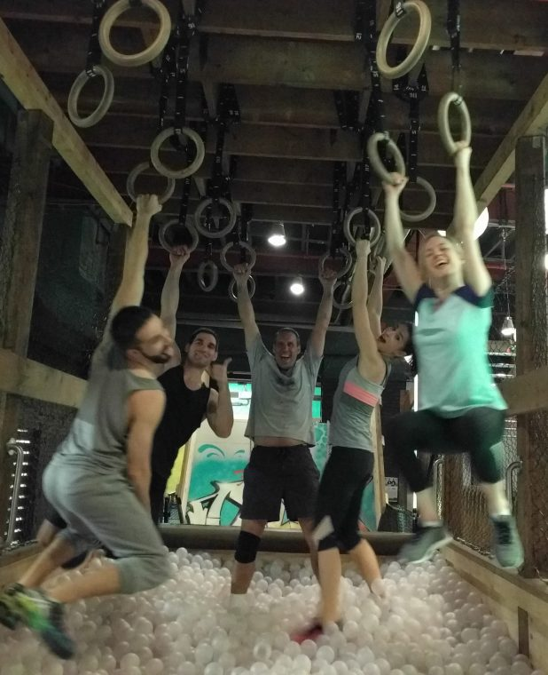 My team and I goofing around in the obstacle course